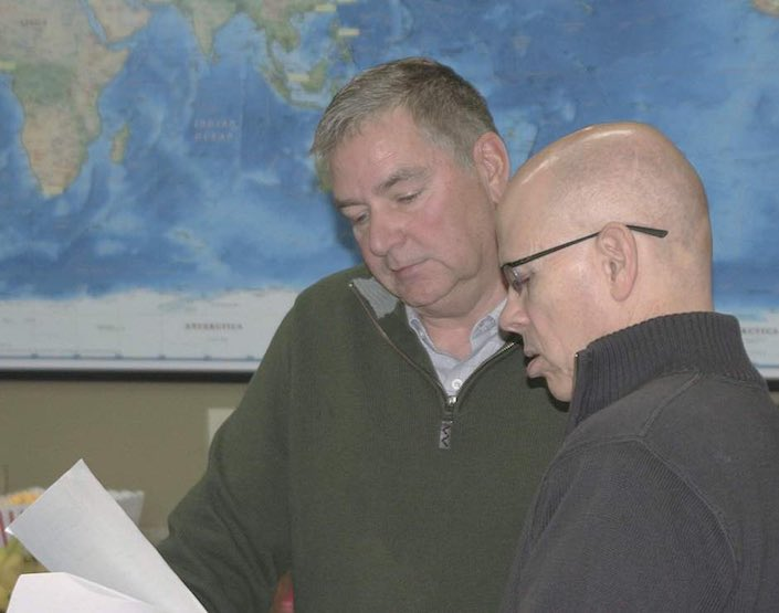 Gary Bailey, new chairman of the Washington Grain Commission, left, goes over paperwork with CEO Glen Squires Jan. 4 during the board meeting in Spokane.