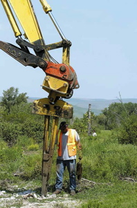 (Kyle Mills) -- Wildland Inc. worker Jose Alvarez loaded one of nearly 8,000 native plants into an expandable stinger attached to an excavator as part of a Lapwai Creek restoration project designed by the Nez Perce Tribe, BPA and NOAA Fisheries, in Lapwai, Idaho, May 17. The trees and shrubs being planted 40 acres along Lapwai Creek near Sweetwater will hopefully increase salmon habitat there.